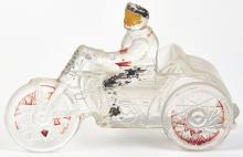 Lot 2477: Man on Motorcycle Candy Container.