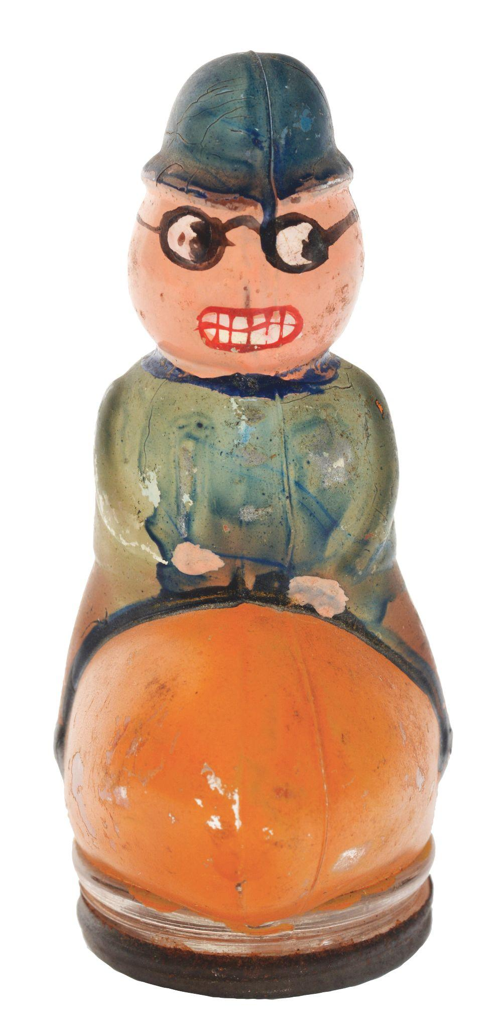 Lot 2478: Policeman Riding Pumpkin Halloween Candy Container.