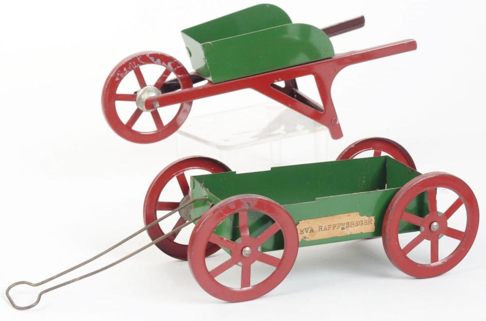 Lot 2543: Lot of 2: Tin Wheelbarrow & Tin Wagon Candy Containers.