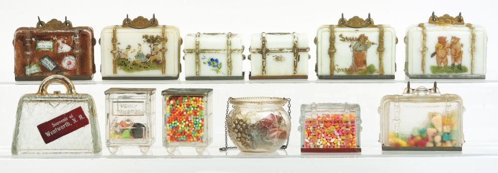 Lot 2557: Lot of 12: Luggage Related Candy Containers.