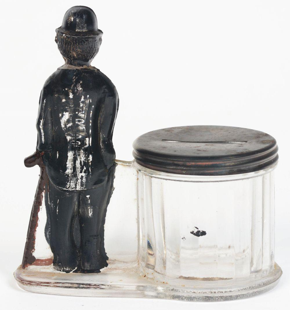 Lot 2567: Charlie Chaplin by Straight Barrel Candy Container.