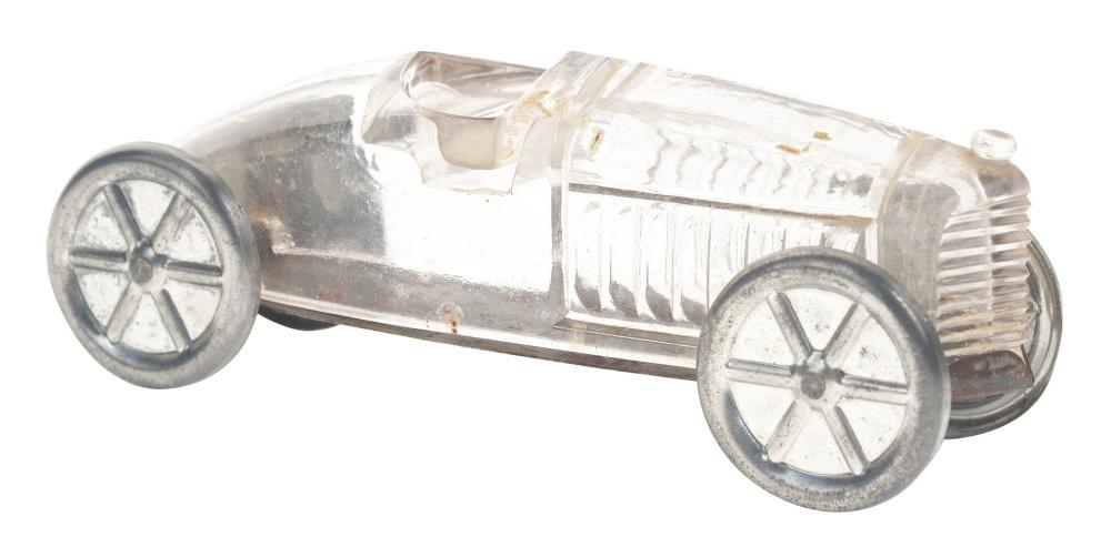 Lot 2580: Glass Candy Race Car with Tin Wheels.