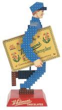 Lot 2591: Whitman's Chocolate Advertising Figure.