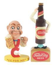 Lot 2594: Lot of 2: Advertising Figures - Utica, Falls City.