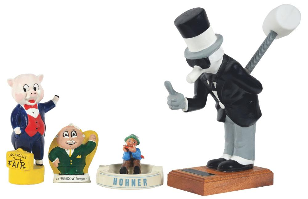 """Lot 2627: Lot of 4: Advertising Figures - Hohner, LA County Fair, """"Meadow Brook"""", Western Exterminator."""