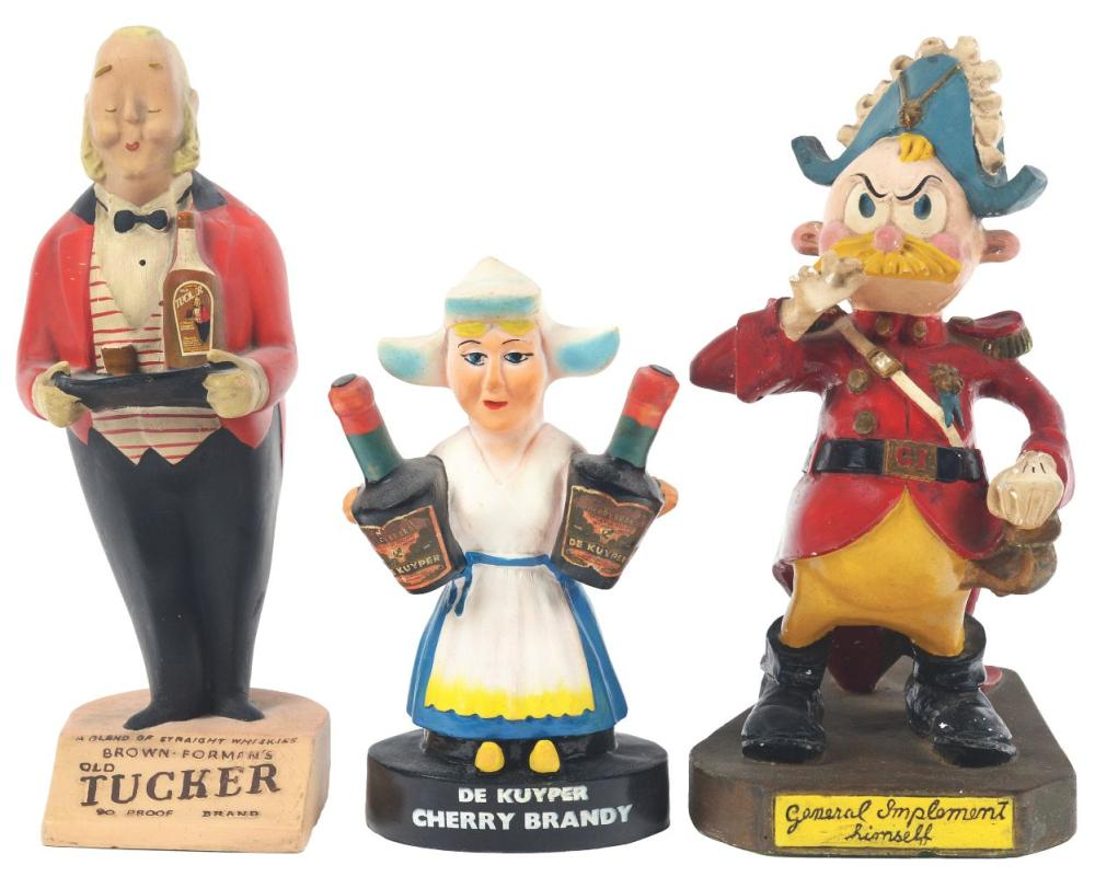 Lot 2645: Lot of 3: Advertising Figures - Old Tucker, General Implement, De Kuyper.