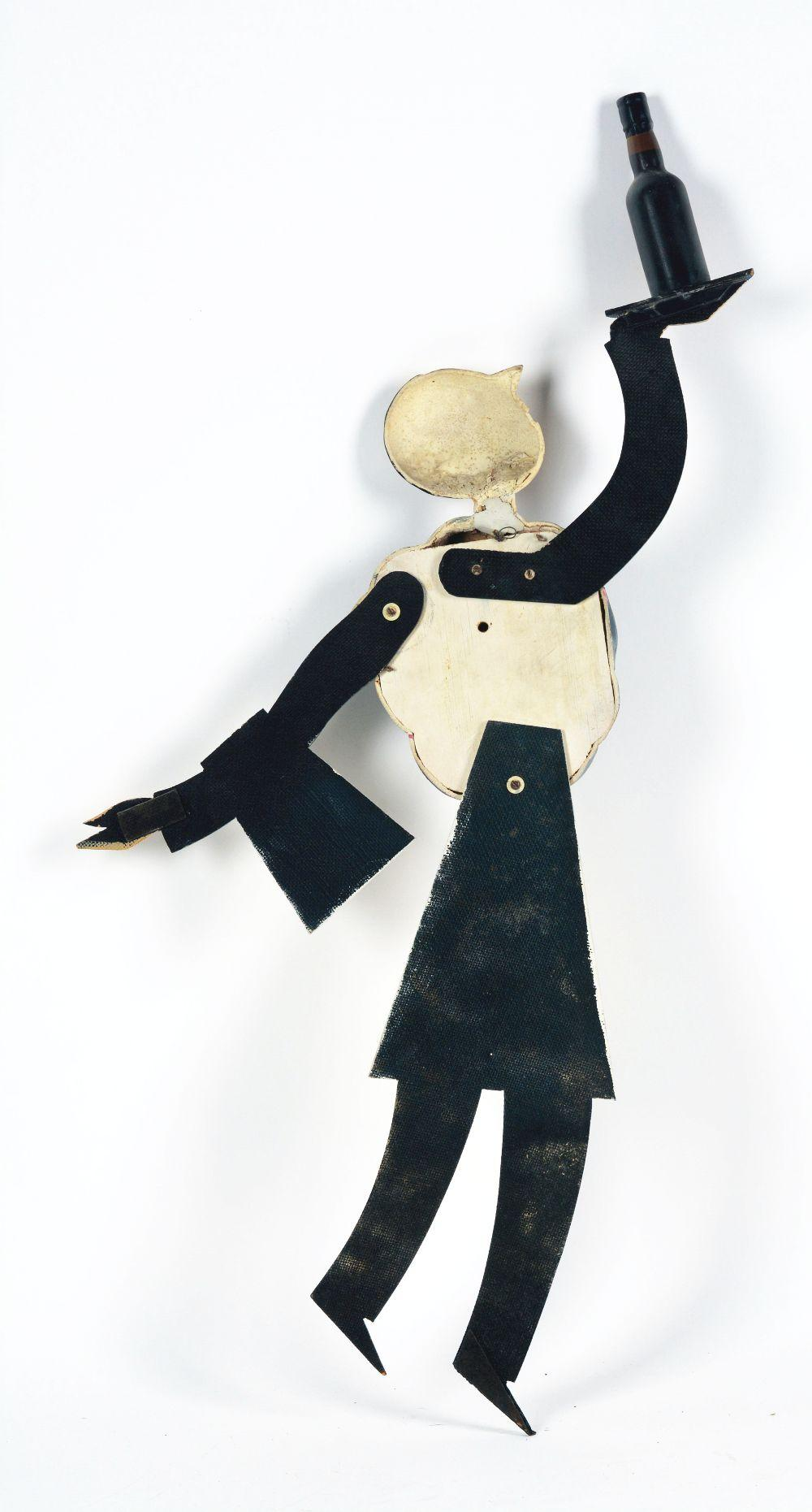 Lot 2705: Rich Ruby Advertising Figure.