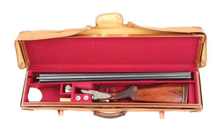 (C) Cased L.C. Smith Ideal Grade Sidelock Shotgun.