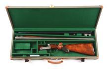 (A) Cased Parker Bros. Model G Double Barrel Hammerless Shotgun - 2 Barrel Set.