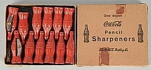 One Dozen Boxed Coca-Cola Pencil Sharpeners.