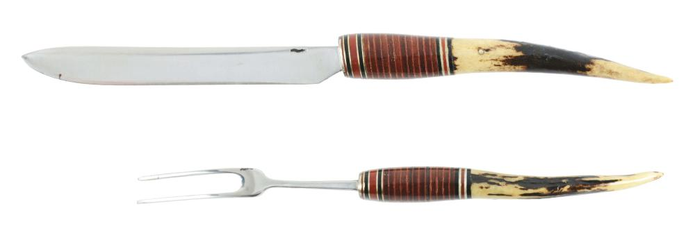 "ELEGANT WILLIAM ""BILL"" SCAGEL TABLE SIZED TWO-PIECE CARVING SET WITH STAG HANDLES."