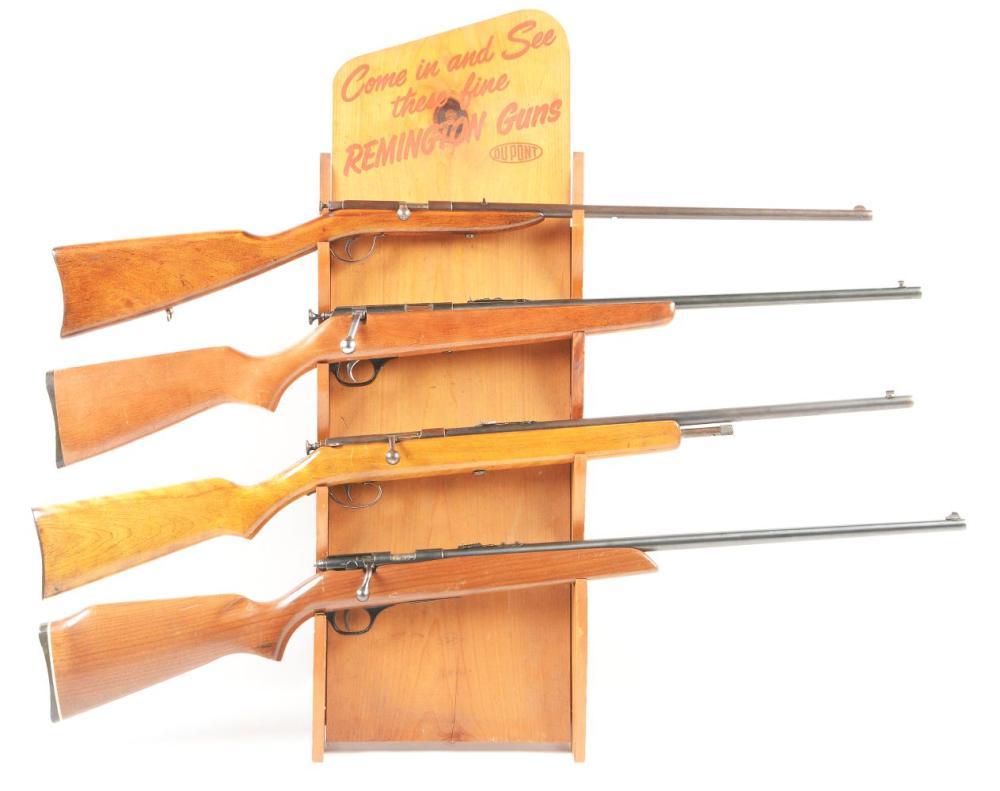 (C) LOT OF FOUR: THREE BOLT ACTION RIFLES AND STAND.