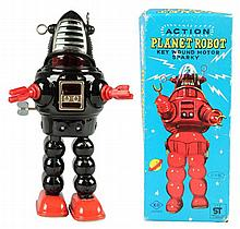 Japanese Wind-Up Planet Robot.