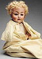 Smiling Character Baby Doll.
