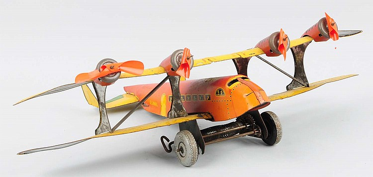 Marx Tin Wind-up US Mail Bi-wing Airplane.