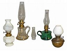 FOUR EARLY SMALL OIL LAMPS