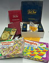 Box of various Games to include Arabian Snakes and Ladders, Draughts, Trivi