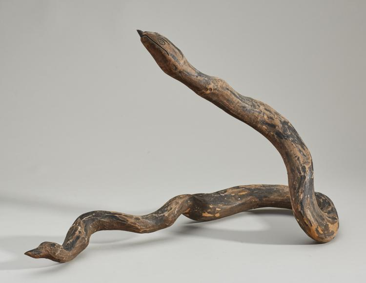 Old root wood carving of a folk art snake