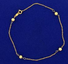 8 Inch Rope Style Bracelet With Gold Beads