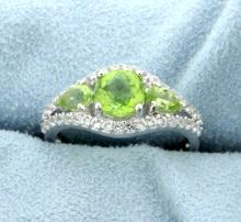 Genuine Peridot Ring accented with White Sapphire gemstones.