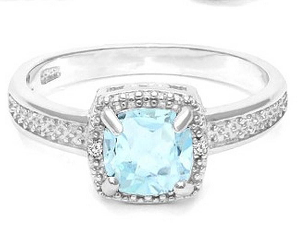 Sky Blue Topaz and Diamond Halo Style Ring in Sterling Silver