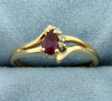 Ruby and Diamond Ring in 14K Yellow Gold