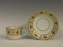 A late Caughley fluted cup and saucer decorated