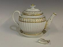 A Caughley fluted teapot, cover and stand with