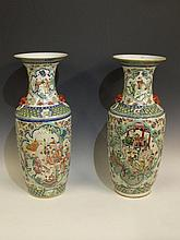 A pair of Chinese famille vert rouleau vases with
