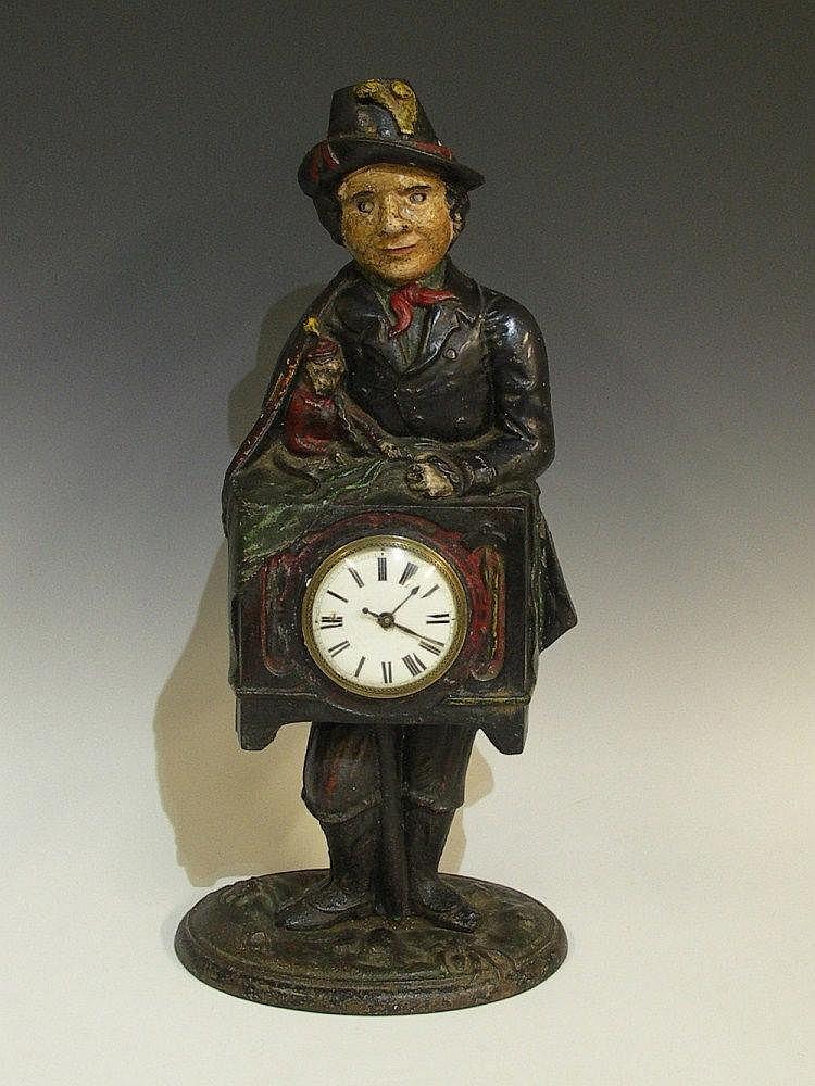 A Victorian cast iron clock case modelled as an