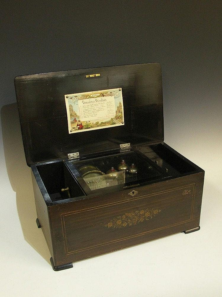 A Victorian Swiss musical box playing eight airs