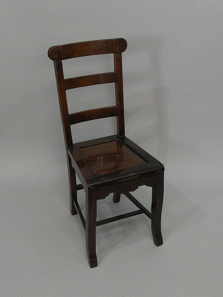 A Chinese hardwood ladderback chair with plain