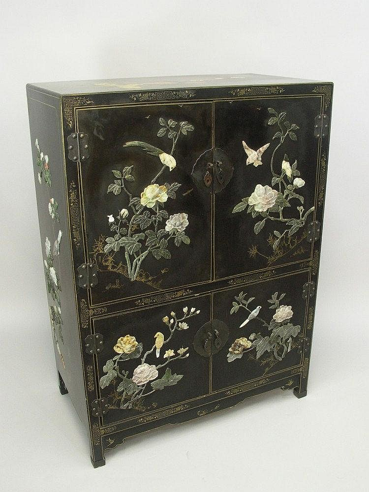 A Chinese hardstone mounted cabinet enclosed by