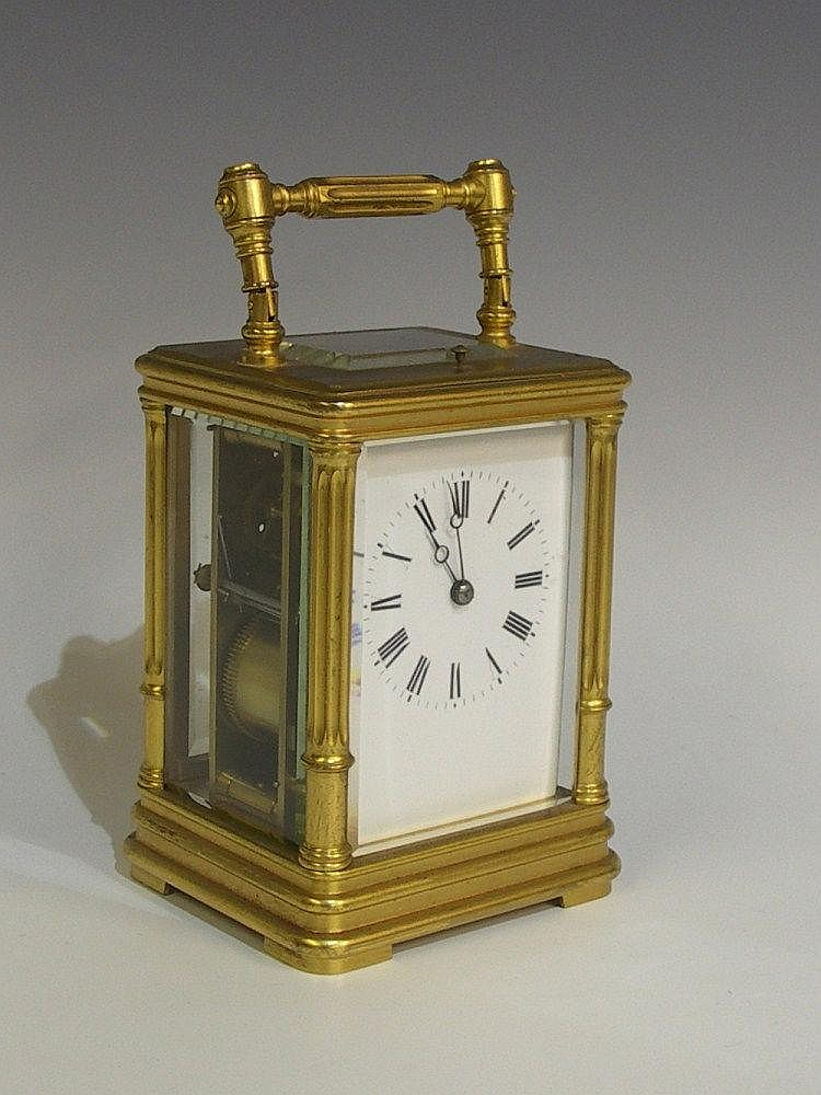 A 19th Century French gilt brass hour repeating