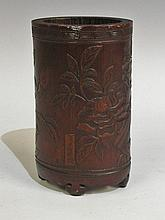 A Japanese bamboo brush pot carved with a bird