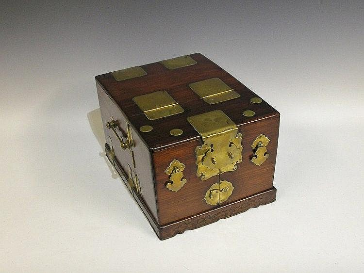 A Chinese brass bound hardwood dressing table box