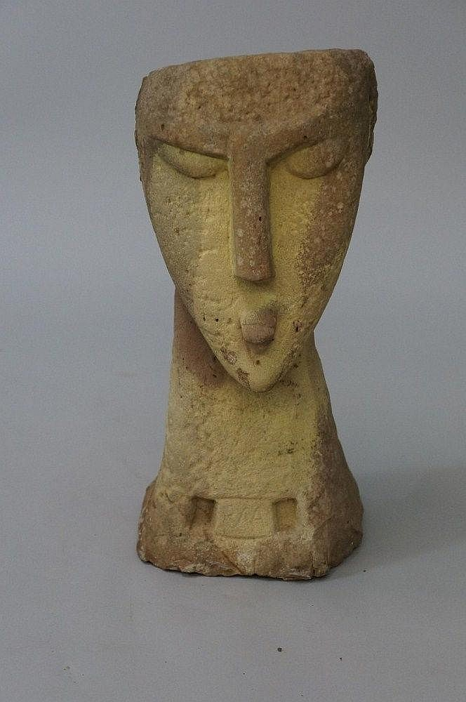 An interesting carved sandstone head of stylised