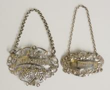 Two silver decanter labels, the first an early Victorian example, pierced,