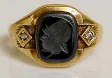 A 9ct gold intaglio and diamond ring the rounded rectangular grey hardstone