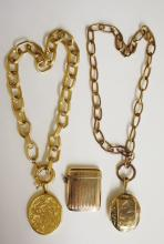 A Victorian gold plated oval locket, the front with raised canted rectangul