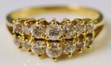 A 14ct yellow gold diamond ring set two rows of seven graduated oval cut di