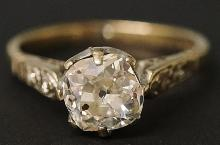 An 18ct white gold diamond ring the claw set rough cut stone approx. 1.09 c
