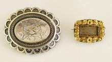 A Victorian shaped oval brooch, the centre foliate engraved, arcaded border