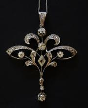 An 18ct yellow gold diamond pendant of stylised leaf design set six old cut