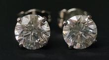 A pair of diamond ear studs the circular cut brilliants claw set in 18ct wh