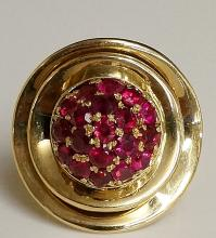 A yellow gold and ruby dress ring the circular domed centre set nineteen ru