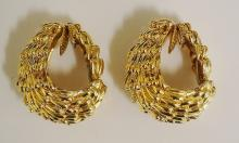 A pair of 18ct gold earrings by David Webb of layered shell form, spring ba