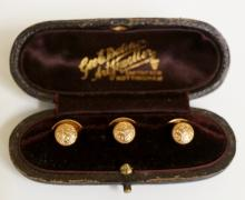 A set of three cased 9ct gold foliate engraved dress studs the box inscribe