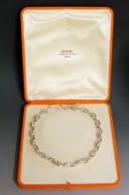Hermes - a silver oval link necklace with T-bar and circle terminals, 43cm