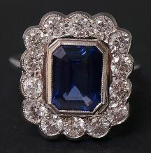 A tanzanite and diamond ring, the Art Deco setting with central baguette cu